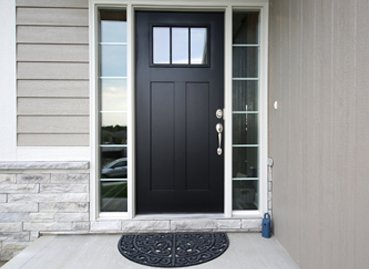 A modern black door installed by a Door Company in Bloomington IL
